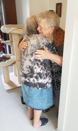 Photo of Tamara at last reuniting with her sister in Finland.